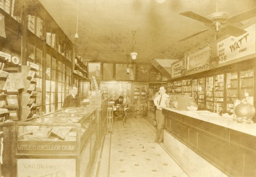 Samuel J. Lee (left) in his Chouteau Ave store in St. Louis, Missouri, circa 1920?