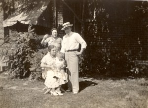 "Four generations of Aikens: Dora (Russell) Aiken sitting, her daughter Dorothy ""Dottie"" (Aiken) Lee, Dottie's son Lloyd Eugene ""Gene"" Lee, and Gene's son Robert Eugene Lee sitting on his great-grandmother's lap. Taken about 1933 at the house on Alamo in St. Louis, Missouri."