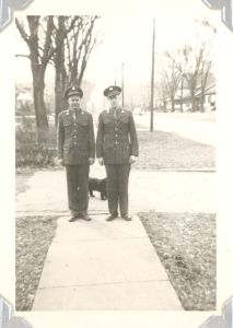 Edward A. McMurray, Jr., in uniform with unknown friend. c1942 in Newton, Iowa.