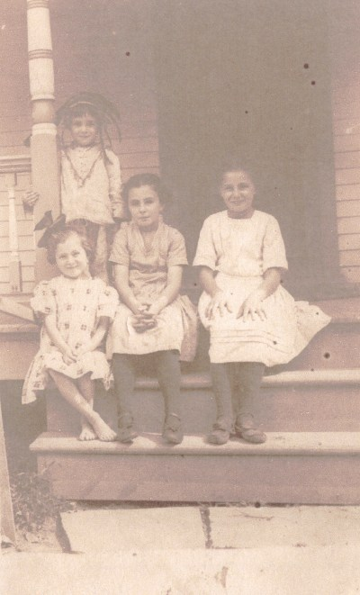 The Cooper Children. Irving Cooper standing in Indian costume. Girls, from left: Loretta, Rose, and Ann Cooper, c1913.