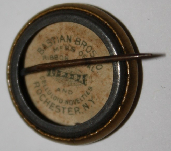 Votes for Women NAWSA Celluloid Pin, early 1900s, reverse. Bastian Bros. Co., Rochester, NY.