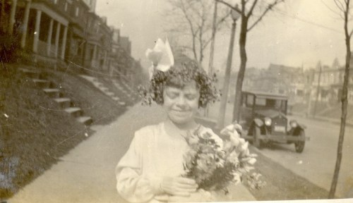 Mary Theresa Helbling In The Procession, April, 1932. Note big hair bow and old car in background.