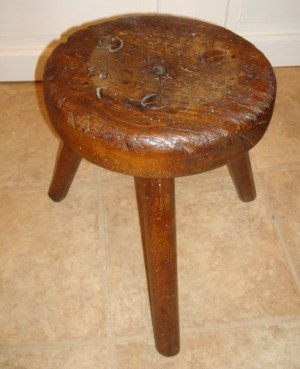An old, well-used milking stool. Via WikiMedia Commons.