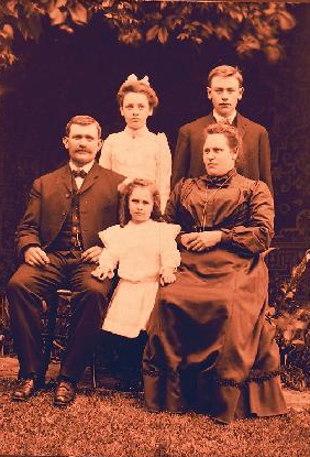 George Anthony Roberts with his wife Ella V. Daniel Roberts and their three children: Ethel Gay Roberts standing in back on left, George Anthony Roberts, Jr. standing on right, and little Edith Mae Roberts between her beloved parents, circa 1904.