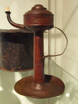 Whale oil lamp of the 18th/20th century. Photographed at Dithmarscher Landesmuseum Meldorf, Schleswig-Holstein, Germany. Iron with cotton wicker.via Wikipedia, CC License.