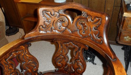 Likely John Broida's chair, brought to US from Eastern Europe; detail of carved backrest.
