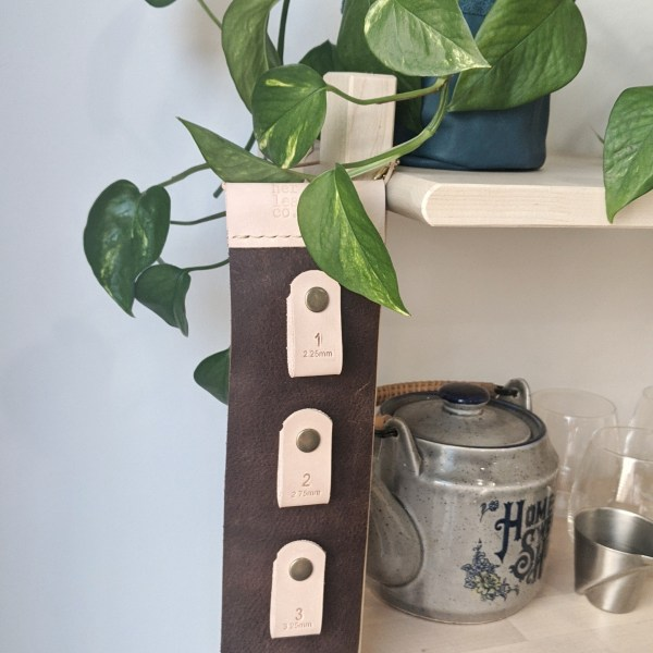 Close up knitting needle wall hanger in kitchen
