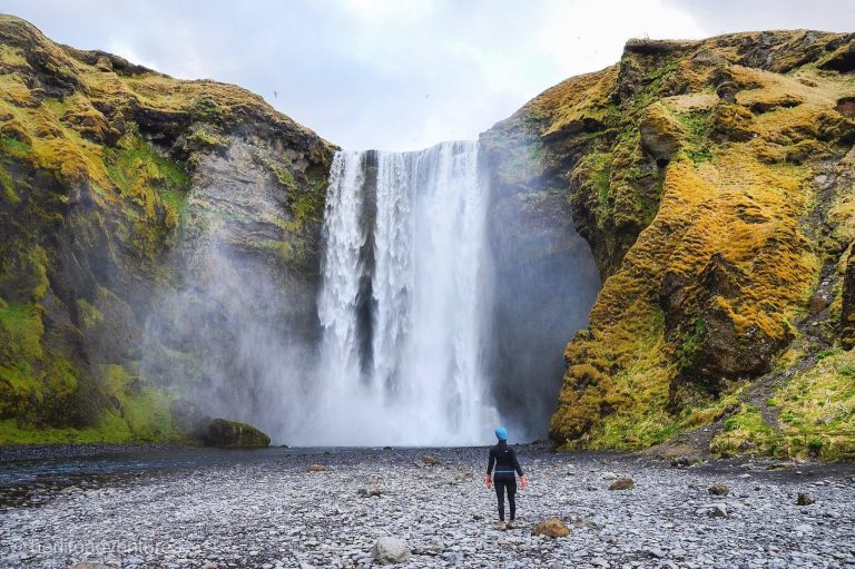 "Visit one of the many waterfalls Iceland has to offer, including the ""rainbow waterfall"" Skogafoss"