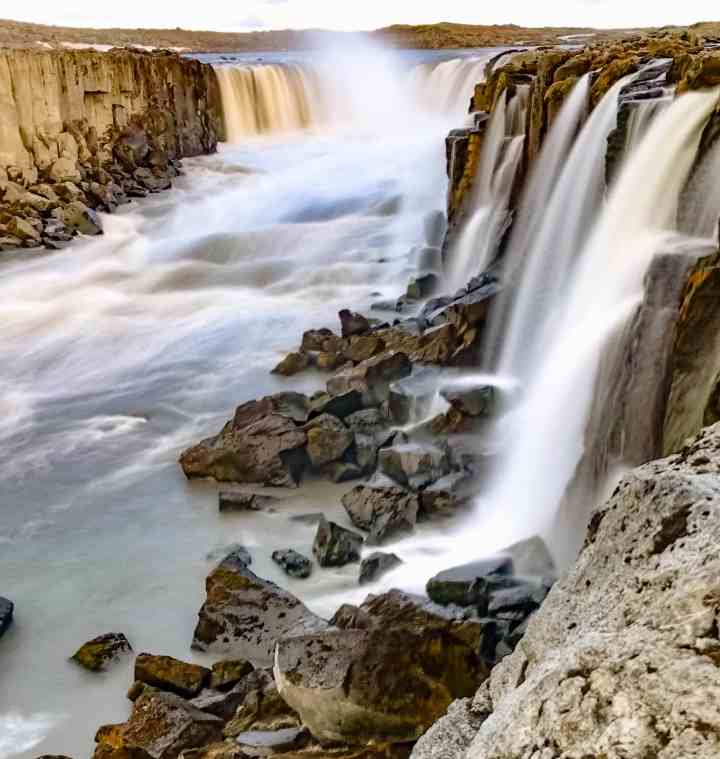 Selfoss, and more must see waterfalls on your Iceland road trip around the ring road.  Hidden gems, cascading waterfalls and some of the most beautiful landscape I've ever seen.   herlifeadventures.blog   #icelandtravel #hiddengem #icelandvacation #travelhacks #travelguide #adventuretravel #traveltips #europe #traveldestinations #travelexperience #waterfalls #iceland #beautifulplaces #adventure #explore