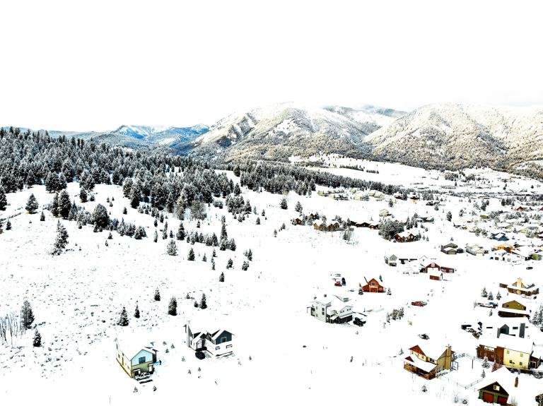 Drone Shot Big Sky Montana The adventure guide to Big Sky Montana in the winter. | herlifeadventures.blog | #traveldestinations #travelideas #northamericatravel #traveltips #usdestinations #travelhacks #travelguide #adventuretravel #roadtrip #bigsky #montana #adventureguide #winteractivities #wintertravel