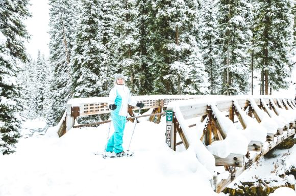 Snow Shoe Bridge Big Sky Montana Winter The adventure guide to Big Sky Montana in the winter. | herlifeadventures.blog | #traveldestinations #travelideas #northamericatravel #traveltips #usdestinations #travelhacks #travelguide #adventuretravel #roadtrip #bigsky #montana #adventureguide #winteractivities #wintertravel