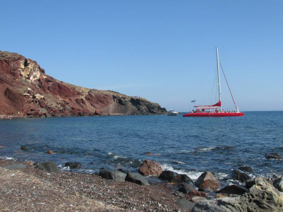 View of the hill that overlooks the Red Sand Beach near Akrotiri from the beach itself.