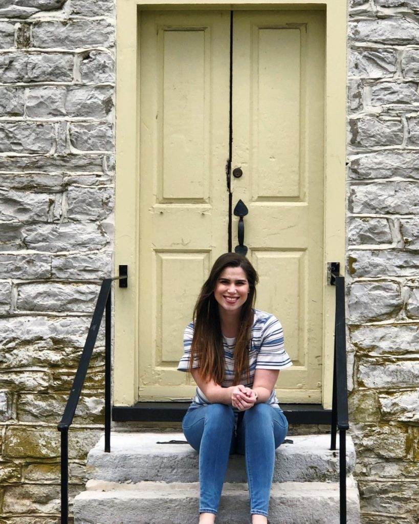 Sitting on the steps of the Farm Deacon's Shop at Shaker Village of Pleasant Hill | Her Life in Ruins
