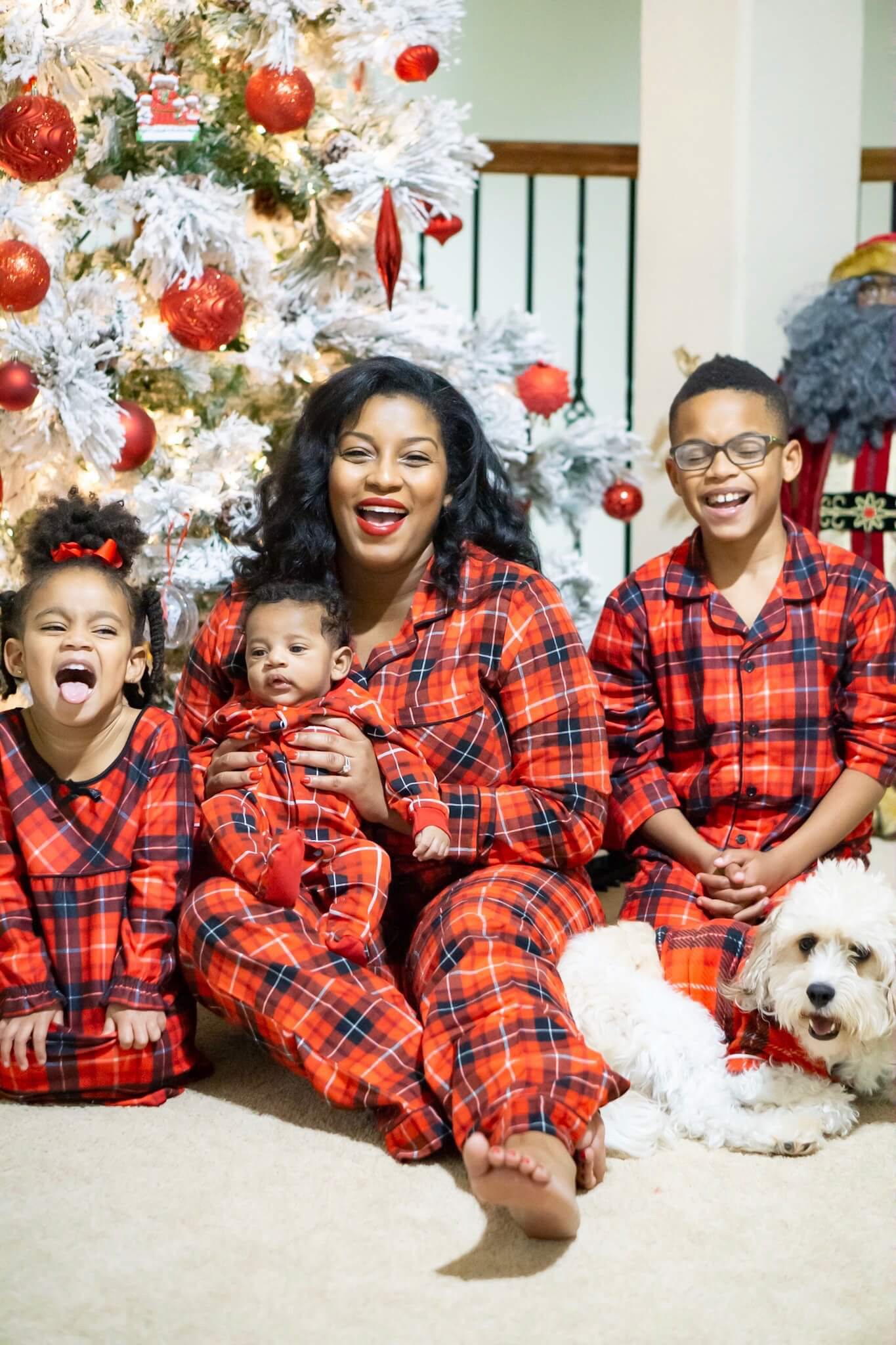 black family in matching christmas pajamas