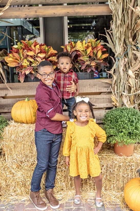 adorable black kids at the pumpkin patch