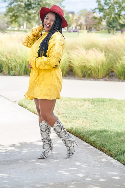 blogger vibes wearing yellow dress and snake skinned boots