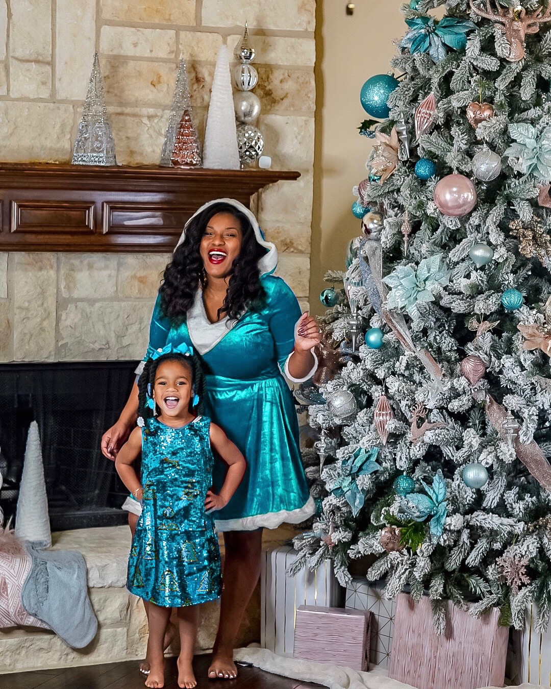 Beautifuly black mom and daughter matching goals as we teach you how to decorate a glam Christmas tree.
