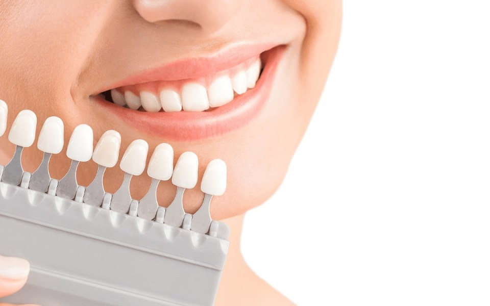 Picture of woman holding dental crowns