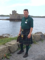 Webmaster, Daniel Neil Leininger in kilt at Kisimul Castle in the summer of 2014.