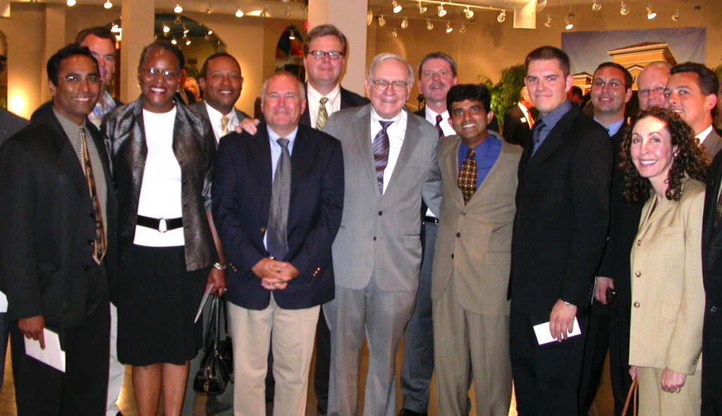 EMBA students with Warren Buffett