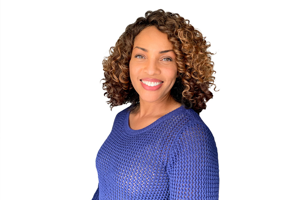 Heroic Headshot on white background of business casual woman taking remote virtual headshot.