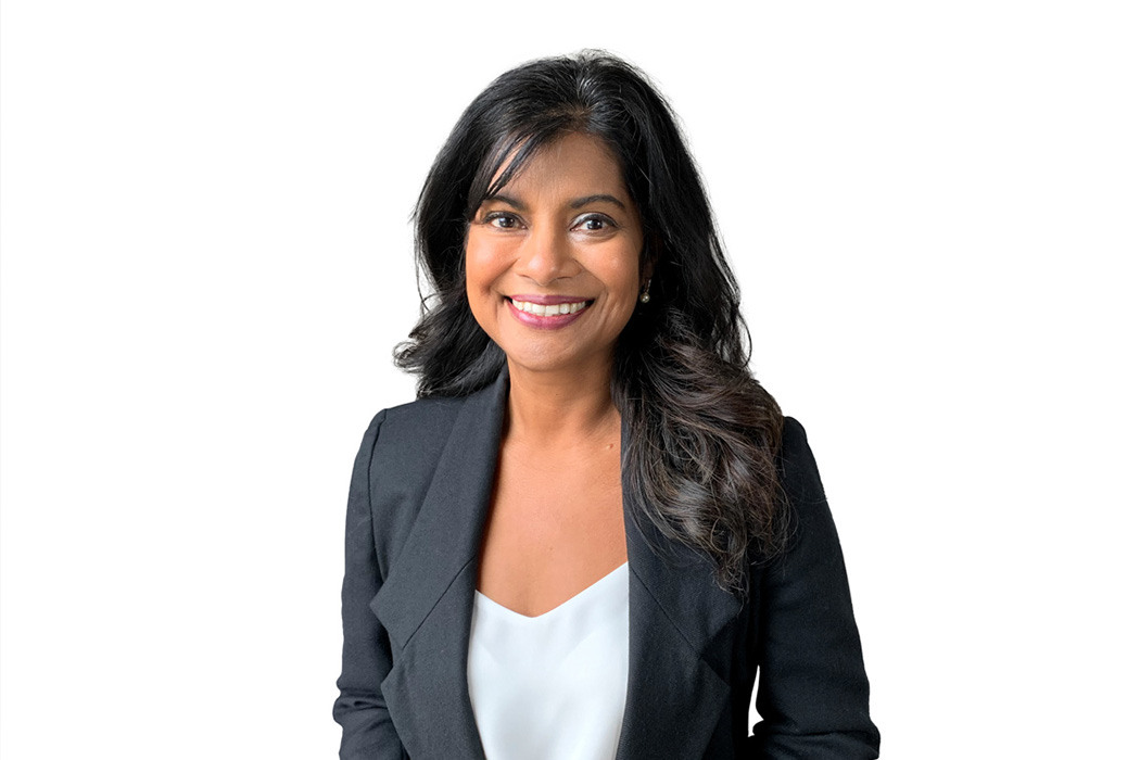 Heroic Headshot on white background of business woman in suit jacket taking remote virtual headshot.