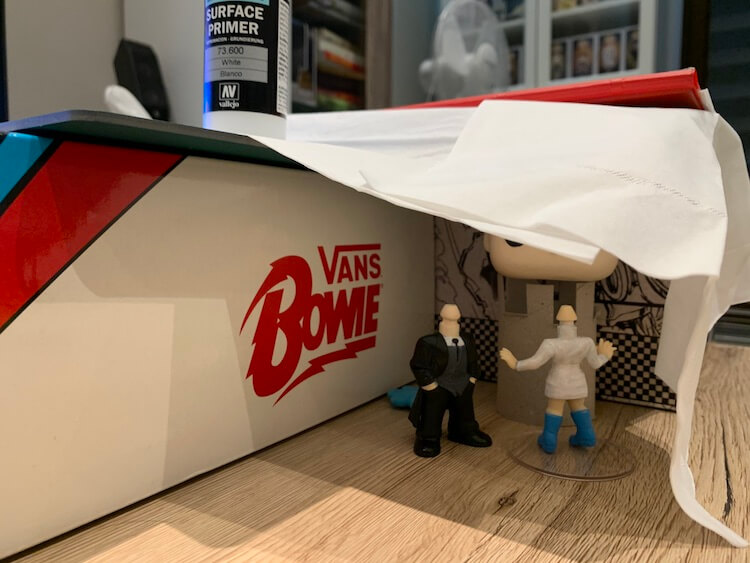 Funko Pop figurines under a tissue with Bowie Vans box