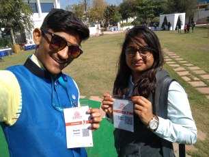 Pravin and a woman showing WordCamp name tags