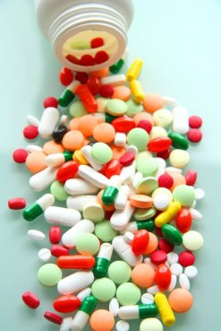 bottle of vitamin D pills and other pills...