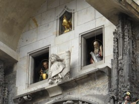 The apostles moving through the window at the hour, with the golden rooster above