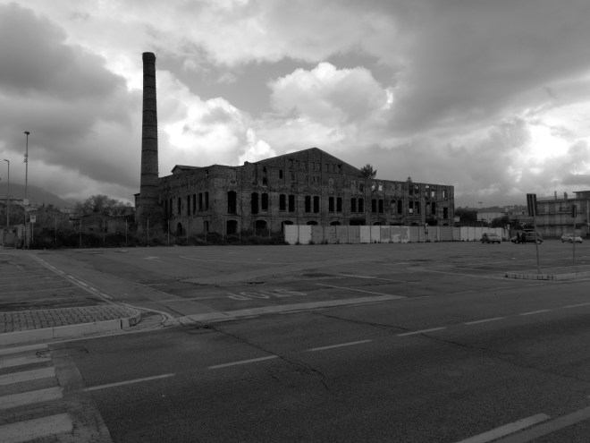 An old abandon manufacturing building in the middle of the city