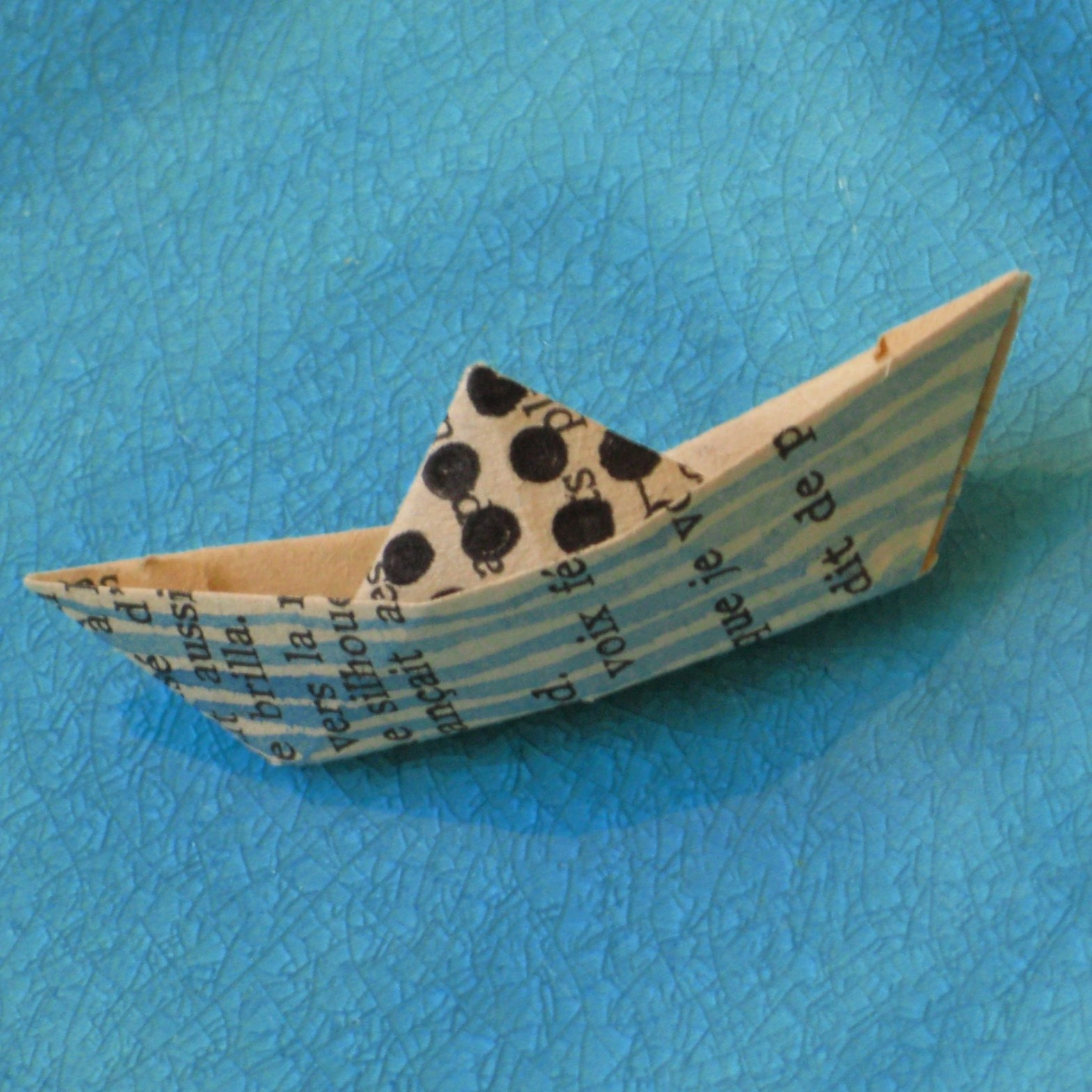 Origami boats made out of old books - art by Tine Steiss