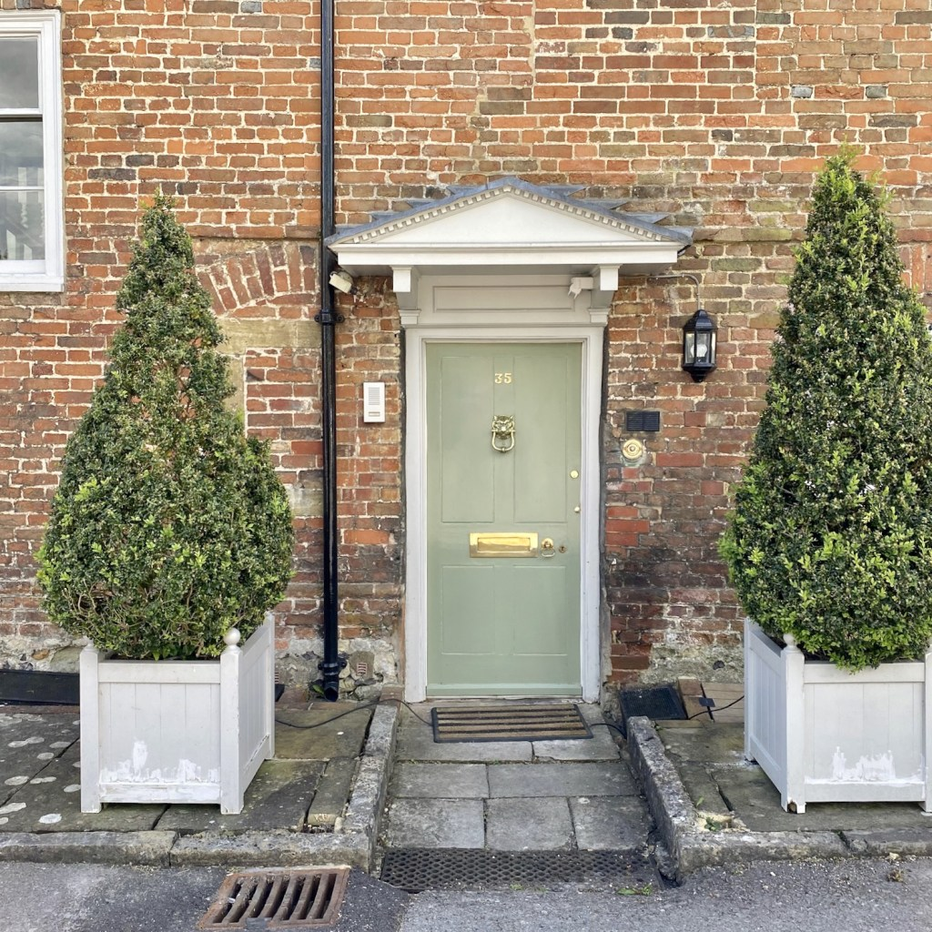 Front door of 35 The Close with ornamental trees