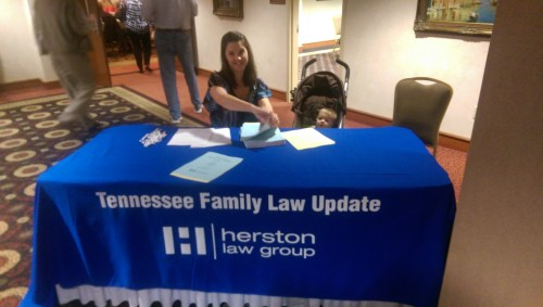 Eight-month-old Evan Weaver assists with registration.