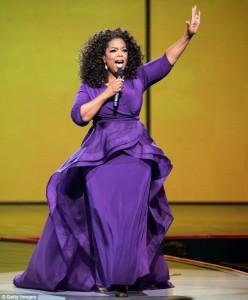 Oprah in a purple dress