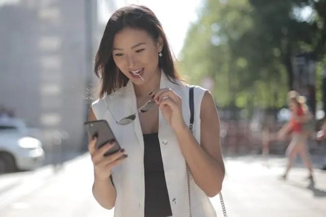 woman holding smartphone