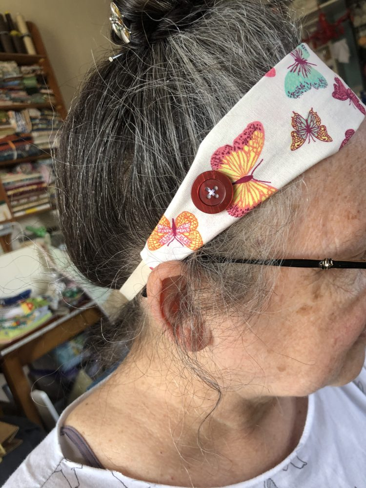 A person modelling a handmade headband for heroes