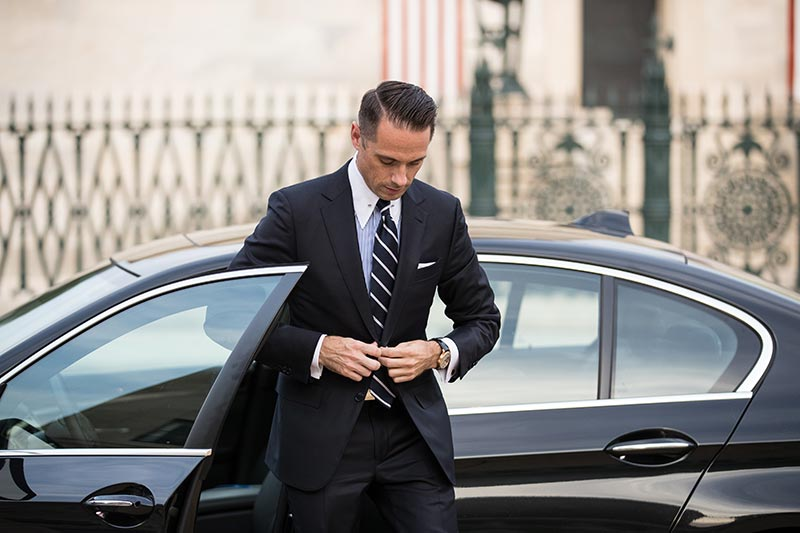 getting-out-of-black-bmw-in-navy-suit-mens-business-outfits-outfit-ideas