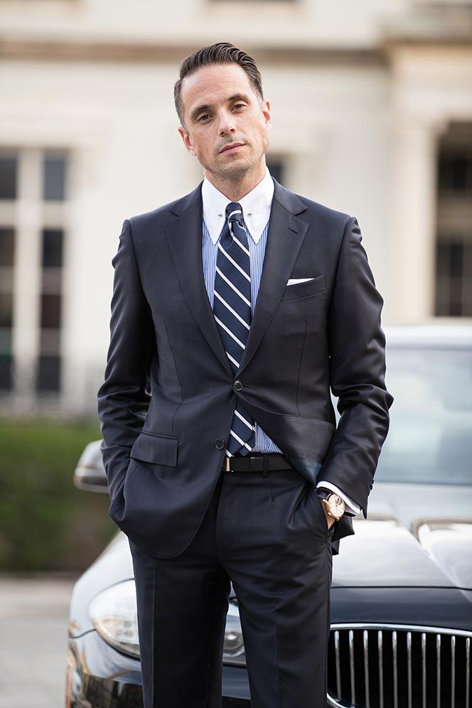 iwc-portugieser-tourbillon-d-h-craig-on-wrist-with-navy-blue-suit-3
