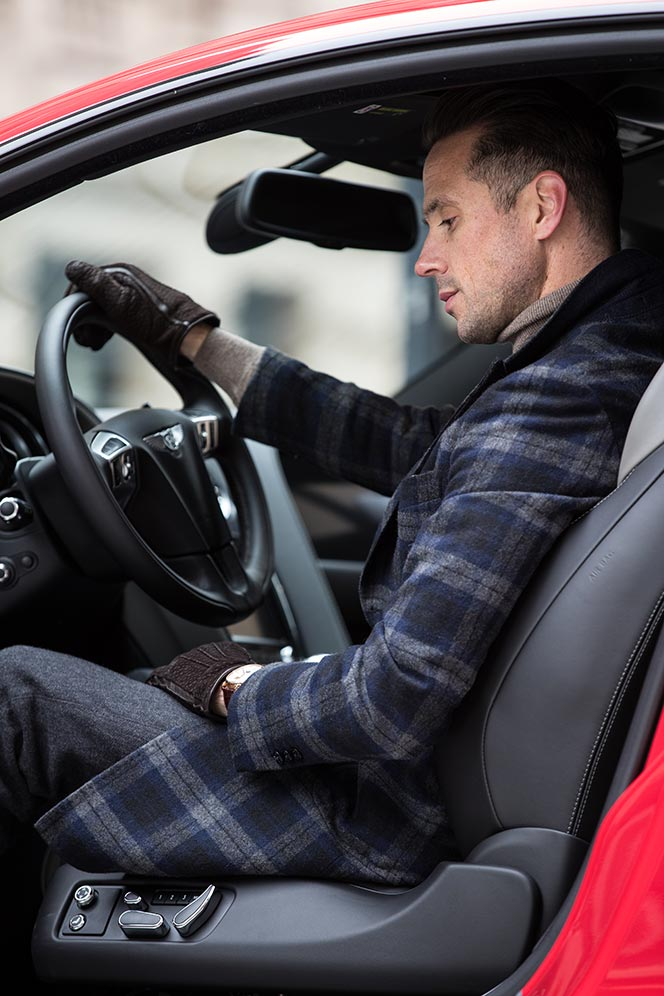 sitting-behind-wheel-getting-ready-to-start-2017-bentley-continental-gt-speed-black-edition-st-james-red-color