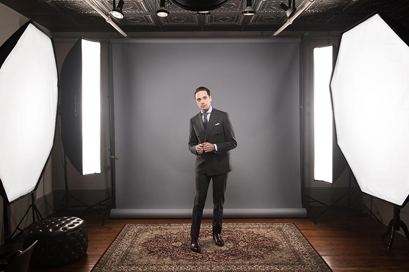behind-the-scenes-camera-studio-lighting-set-up-he-spoke-style-grey-double-breasted-flannel-suit