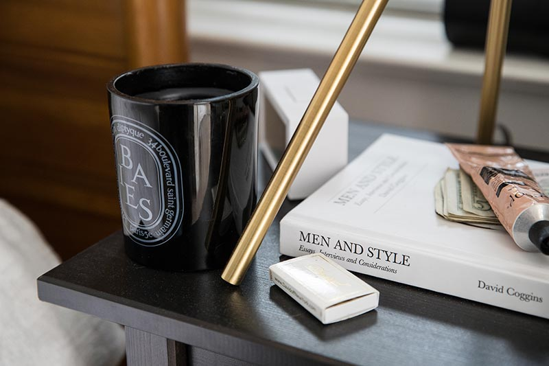 candle-and-book-on-bed-side-table