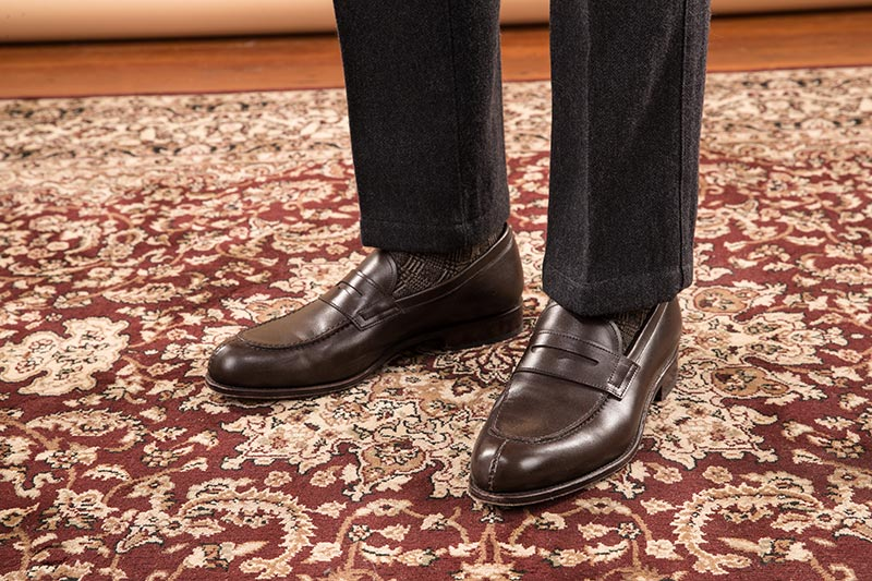 dark-brown-chocolate-leather-penny-loafers-with-grey-wool-pants-on-persian-rug