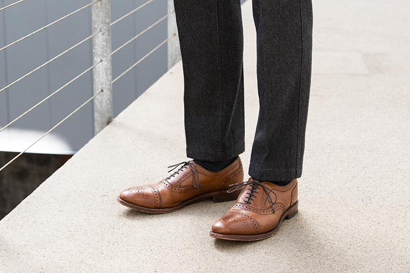 walnut-leather-brogue-cap-toe-shoes-allen-edmonds-strand-with-grey-pants-classic-mens-style