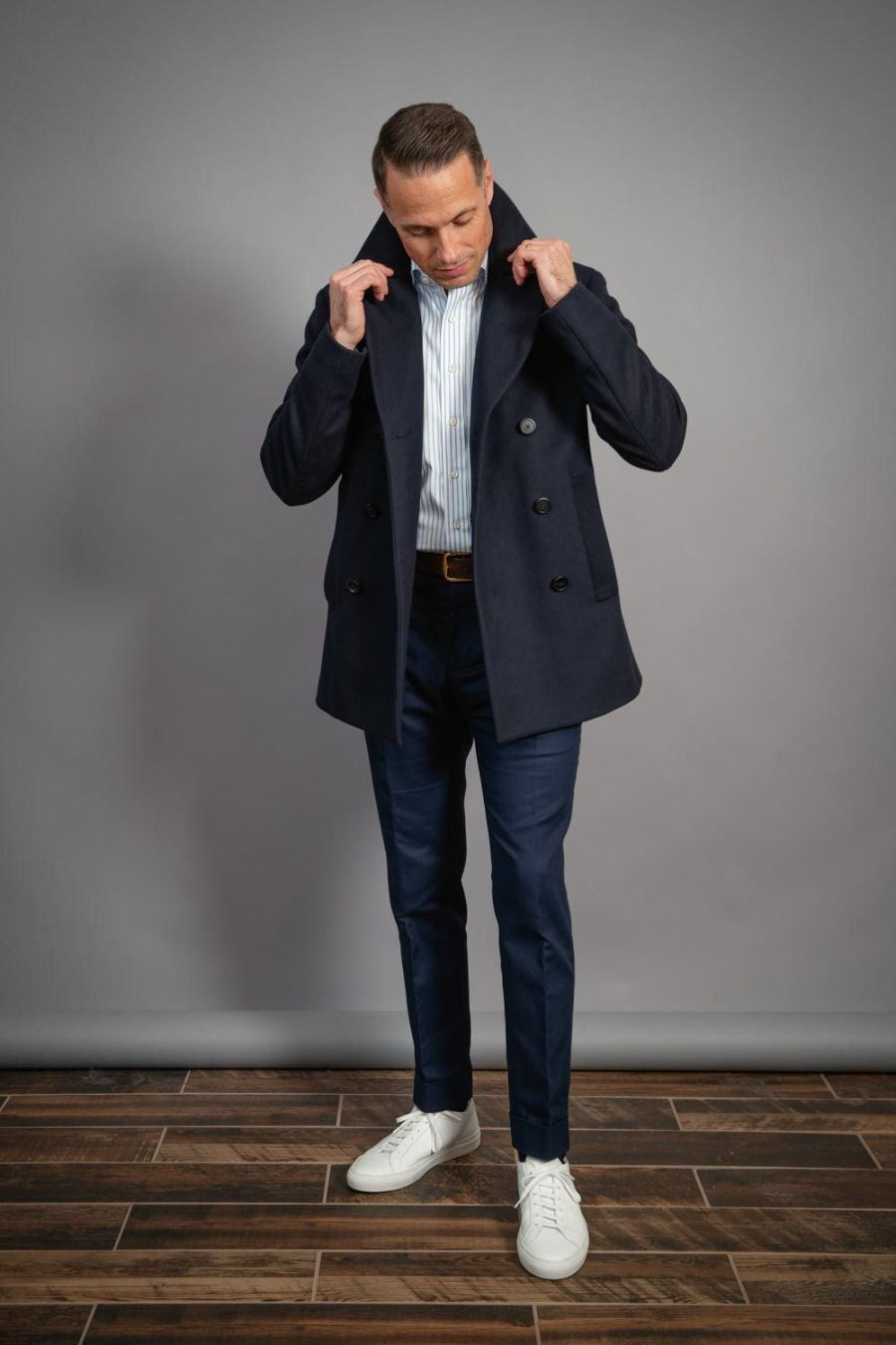 most-versatile-coat-for-men-with-white-sneakers-navy-trousers