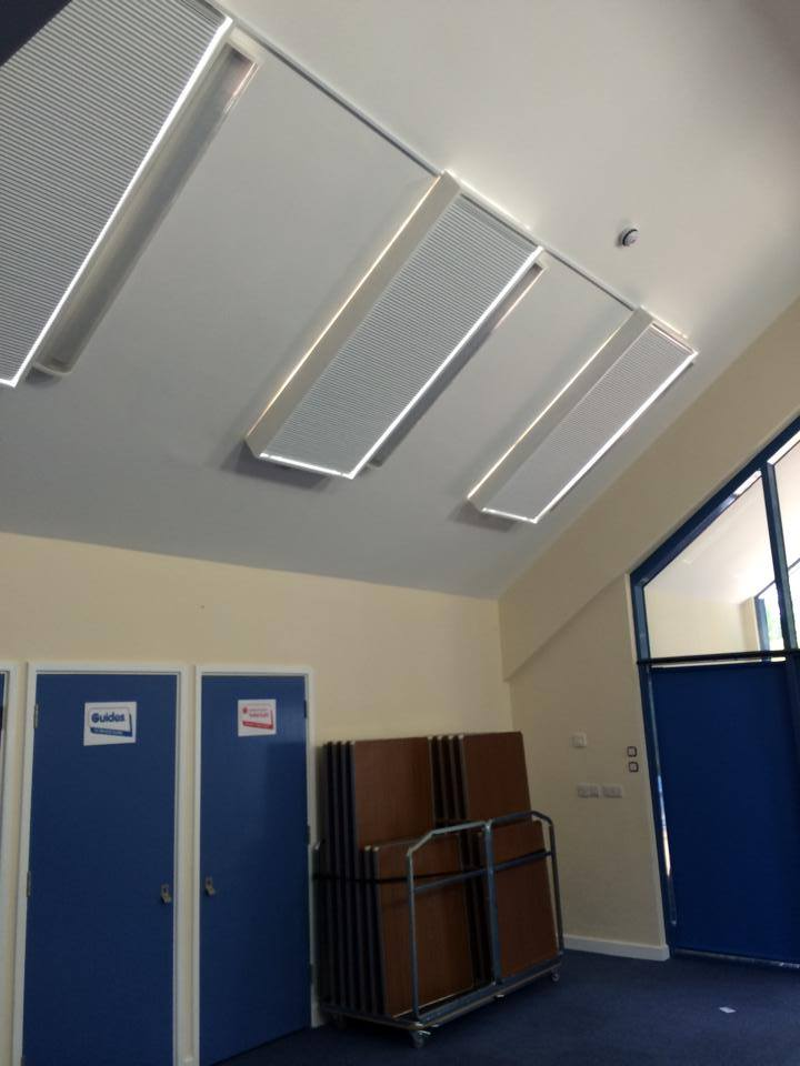 Girl guides and black out pleated roof blinds closed.