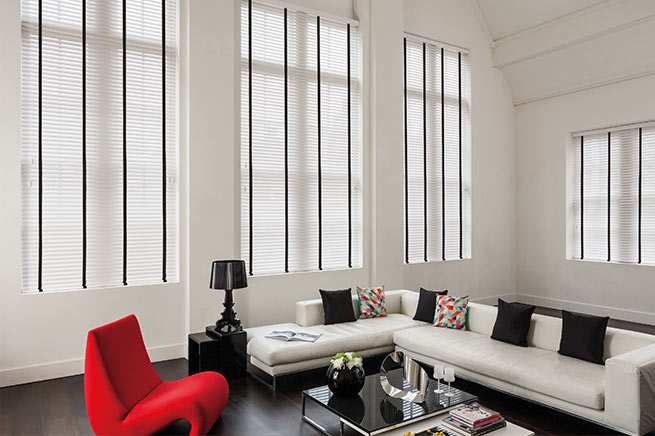 White wood venetian blind with black tape
