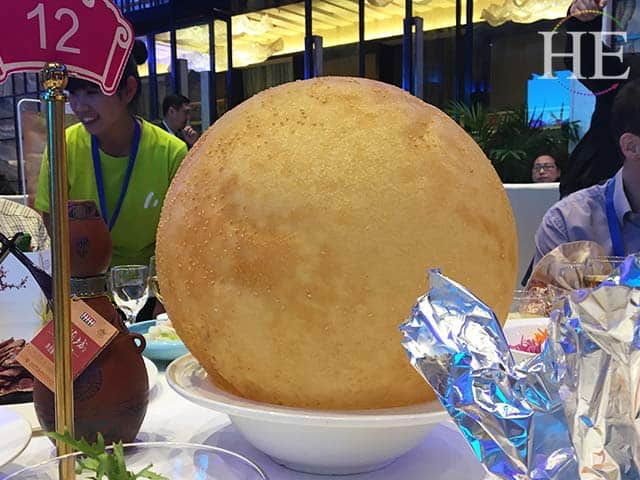 ginormous and delicious sesame ball at a water banquet in luoyang china