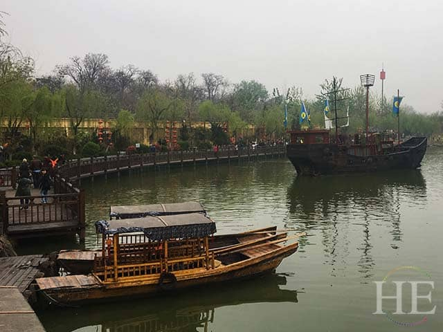 replica boats sit quietly in a river in kaifeng city china