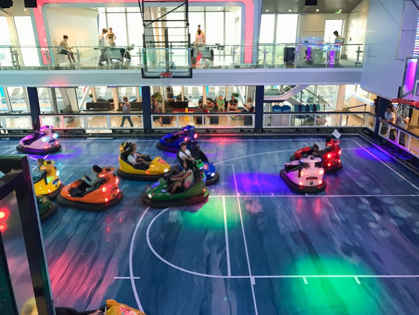 Bumper cars on a court, mid-action